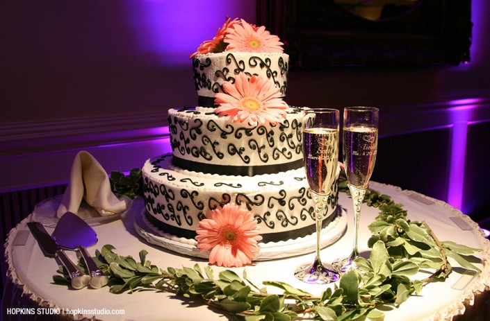 Black and white cake with pink daisies